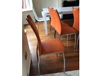 Beautiful bargain orange dining chairs - £80