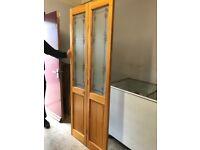 DOUBLE WOODEN INTERNAL FOLDING DOOR HEIGHT 6FOOT 5``WITH GLASS PANELS