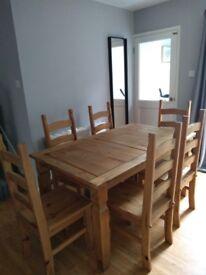 Corona solid pine dining table and chairs. Excellent condition, 4 or 6 chairs available