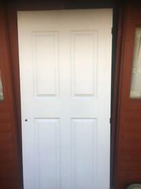 """Interior door , 4 panel almost new. Already cut for handles and hinges. 6'6"""""""" x 2'6""""."""