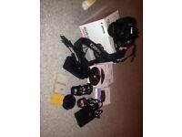 Canon EOS 650D DSLR digital camera and extras