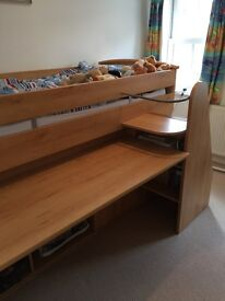 Cabin bed with integrated drawers, shelved compartments and pull-out desk