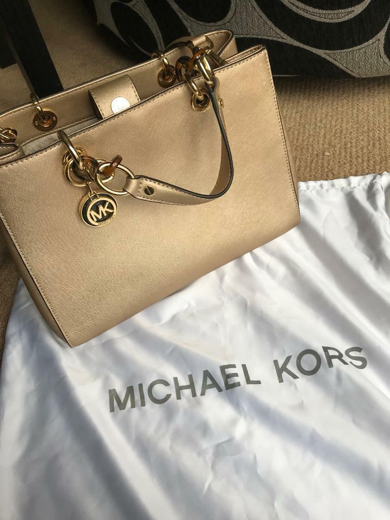Michael Kors Gold Medium Size Hand Bag With Cross Body Strap And Dust