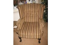 Wing back chair in brown/gold striped fabric ~Good clean condition Footstool included