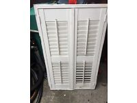 Frame with shutters in one of