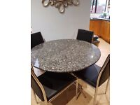 Dark Granite Round Table with Chrome Legs and 4 chairs