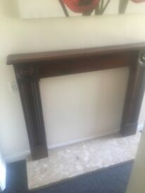 Wooden fire surround with solid marble back and base