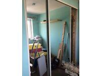 Pair of sliding mirrored wardrobe doors
