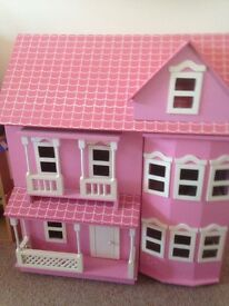 Wooden dolls house with furniture and figures. £40.