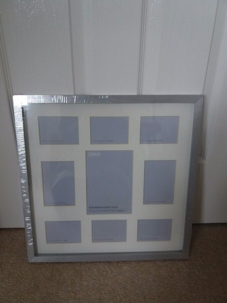 Multi Aperture 9 Large Photoframe Display, In Silver. New In Packaging