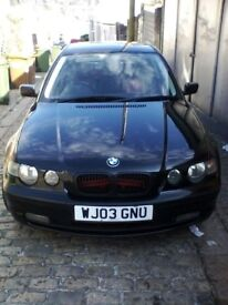 Black BMW 320td Compact with red/black leather interior etc.