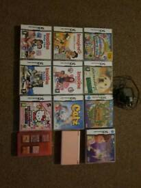 Pink dsi with charger & 17 games