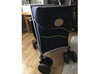Sholley shopping trolley. As new condition. Used twice. Good walking aid.