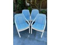 Four plastic sturdy garden chairs with cushions