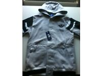 addidas tracksuit, large ,brand new . Open to close offers.