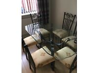 Glass top table with 6chairs and console table