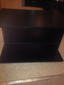 small tv stand and two puffy's