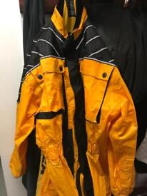 Waterproof one piece motorcycle or scooter suit