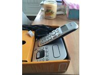 Silver home phone with answering machine
