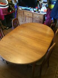 Sturdy, family dining table and four chairs