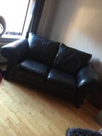 2x 3 Seater black leather suites from Reid's
