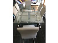 6 - 10 seater glass extendable dining table and chairs