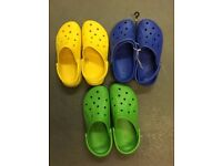 3 pairs of Crocs in assorted colours - size M10/W12
