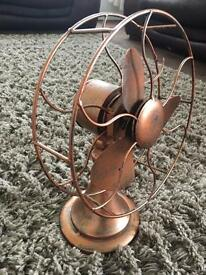 Quirky decorative metal fan