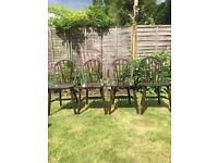 4 used kitchen/dining chairs with signs of wear and tear