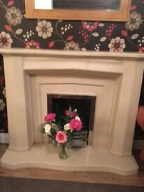 Stone fire surround, mantle,hearth with gas fire