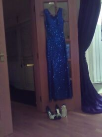 Ladies sparkling blue evening dress shoes and clutch bag to match