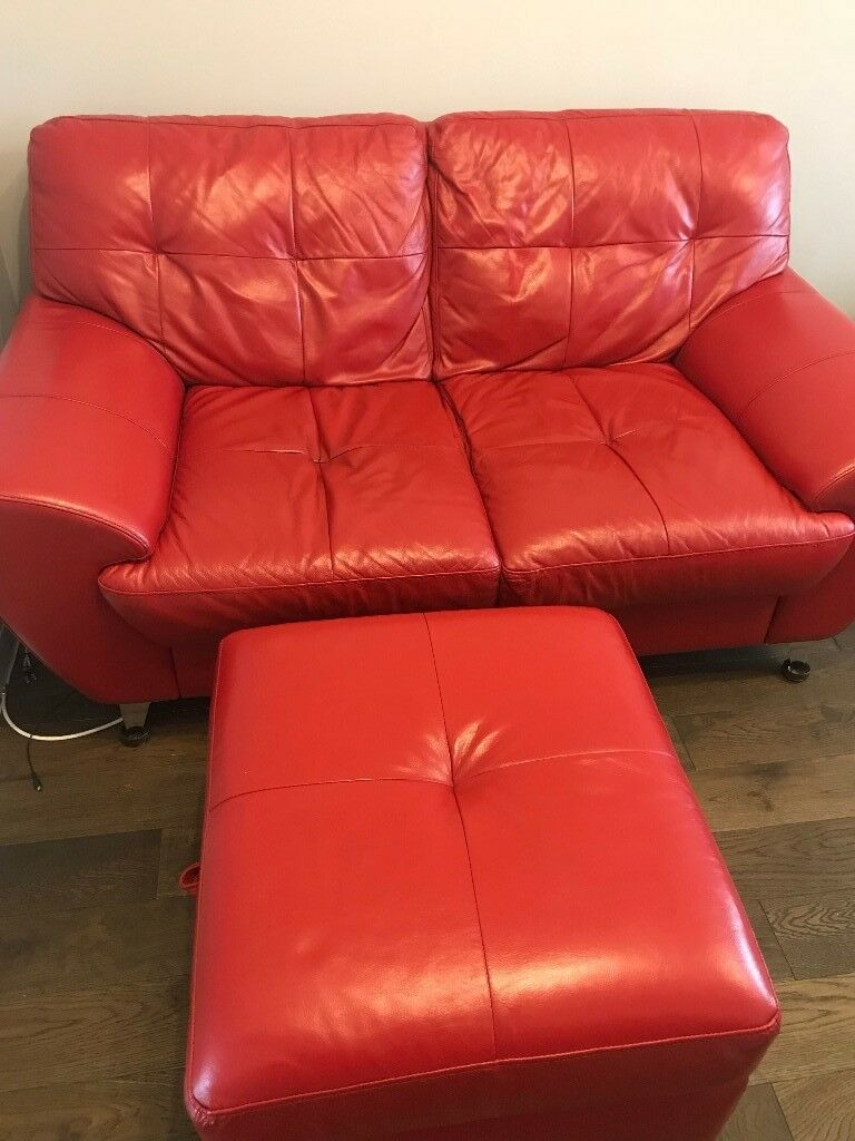Red leather two seater sofa, with matching armchair & poof/footstool