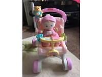 Fisher Price walker pushchair with soft baby doll