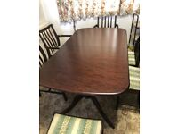 Stag dark brown wood extendable dining table and six chairs
