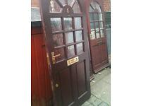 Exterior hardwood door with metal plating on one side