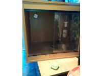 Vivarium for sale. Wooden with sliding glass doors. Wired for basking and daylight lamps.