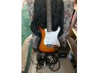 electric guitar with amp. johhny brook 5 string