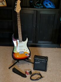 Fender Statocaster replica guitar (by Rockburn) with amplifier