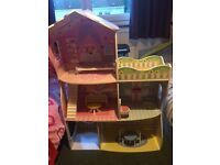 Tall wooden doll house