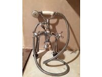Old fashioned bath mixer tap with hand held shower