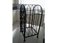 Black Cast iron wine rack holds 10 plus bottles,