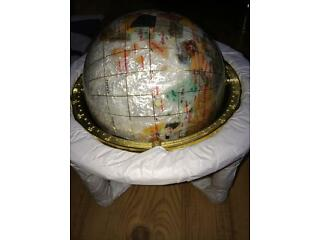 Medium size mother of pearl world globe.