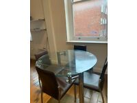 Glass extendable dining table and chairs