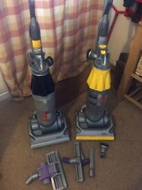 Two Dyson Upright Hoovers