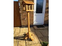 NEVER USED WOODEN BIRD TABLE £20