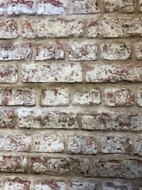 3.5 rolls of brick effect wallpaper