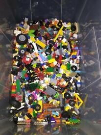 Large quantity of mixed Lego bricks and figures, wheels etc