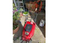 Strong electric lawnmower with long cable.