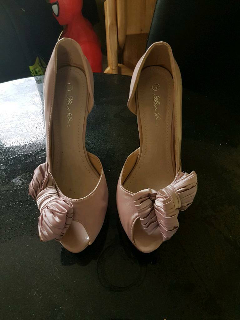 Two pairs heels size 7.