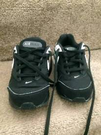 Size 10 boys Nike trainers.